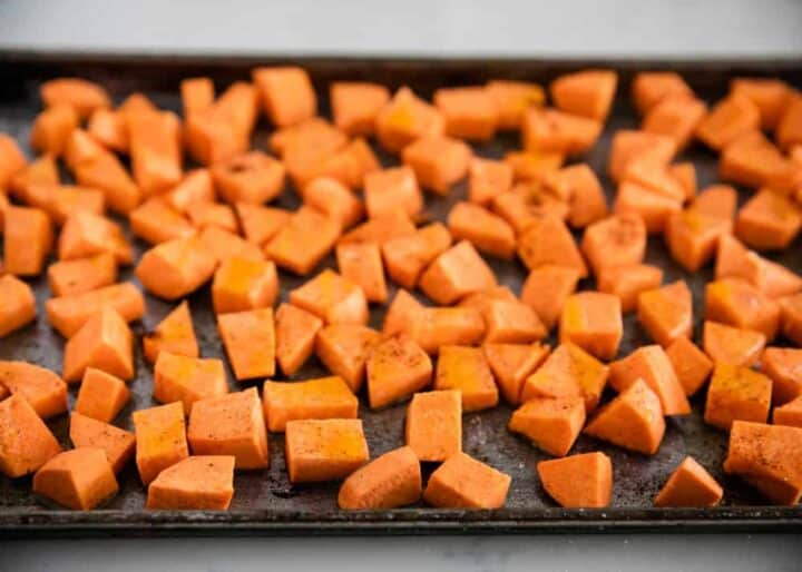 seasoned roasted sweet potato cubes on a baking sheet