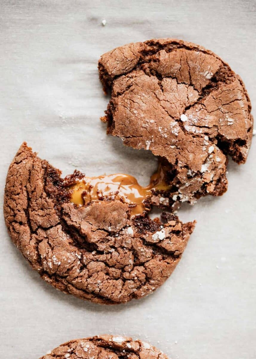 rolo cookie torn in half with caramel oozing out