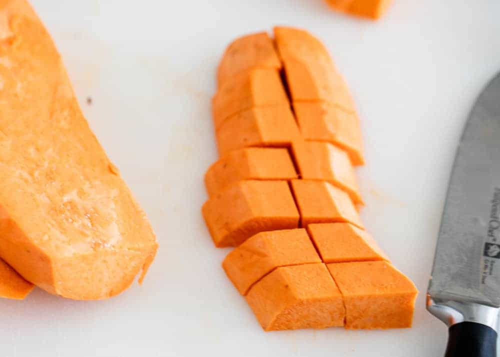 cutting sweet potatoes into cubes