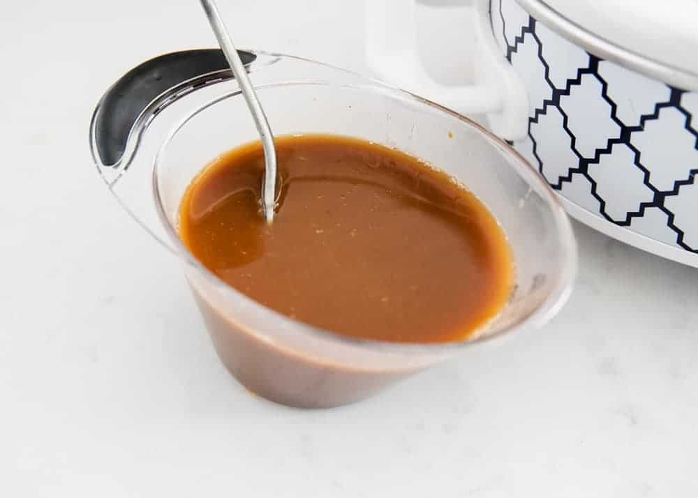 teriyaki sauce in measuring cup