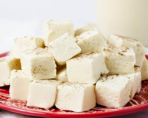 eggnog fudge stacked on a red plate