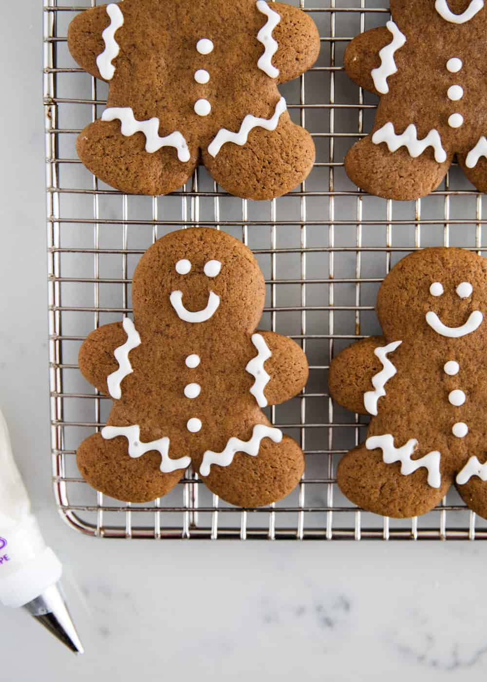 gingerbread man cookies on a cooling rack