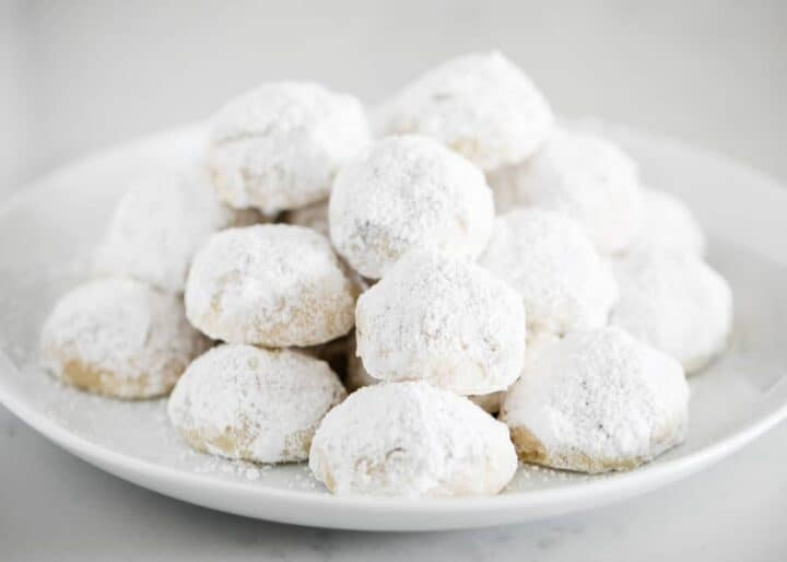 mexican wedding cookies on white plate