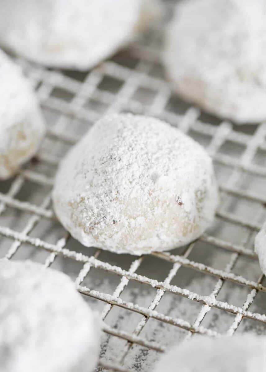 snowball cookies on cooling rack