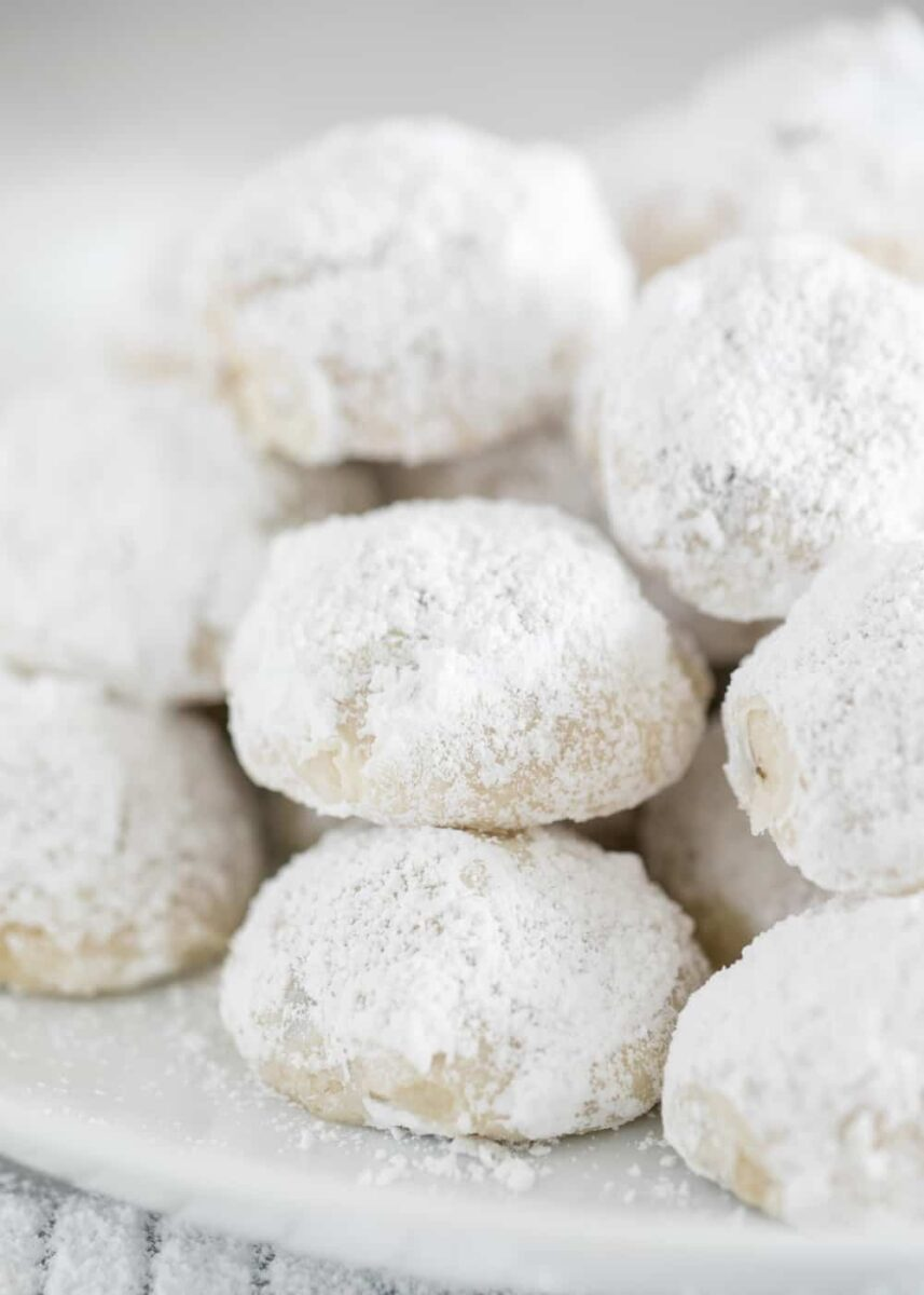 snowball cookies stacked on white plate