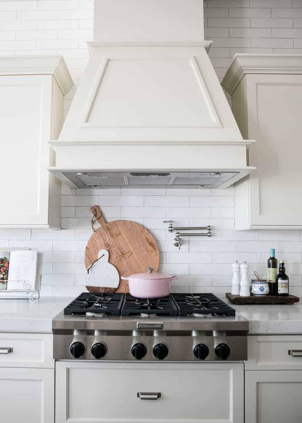 whit subway tile backsplash behind stove