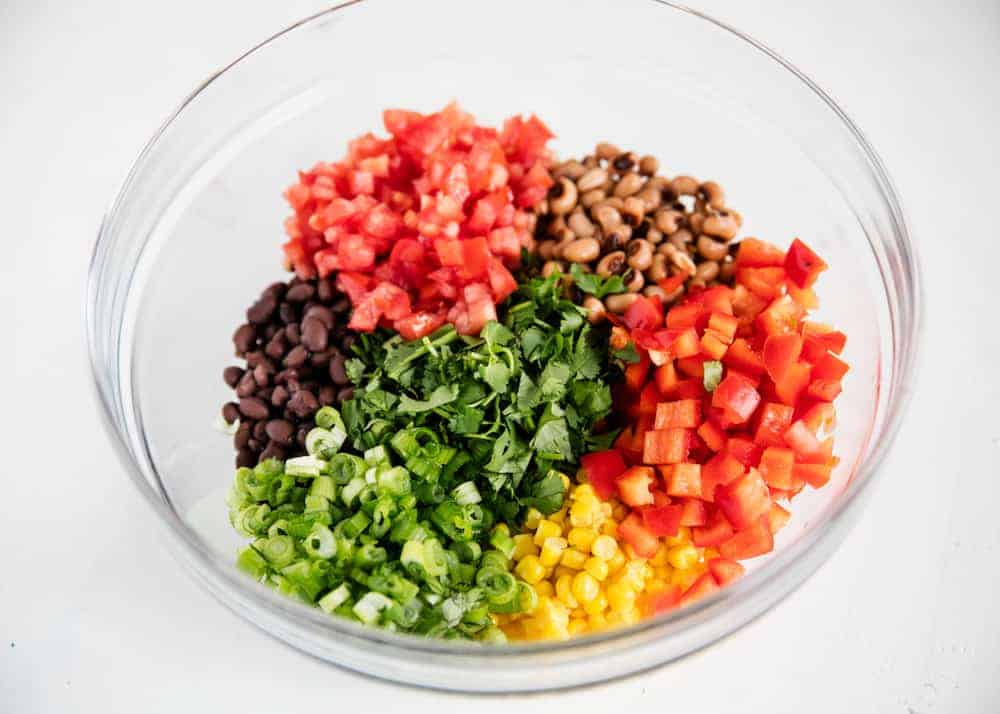 vegetables and beans in a glass bowl