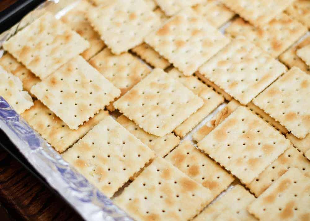 saltine crackers on pan