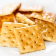 saltine toffee stacked on white plate