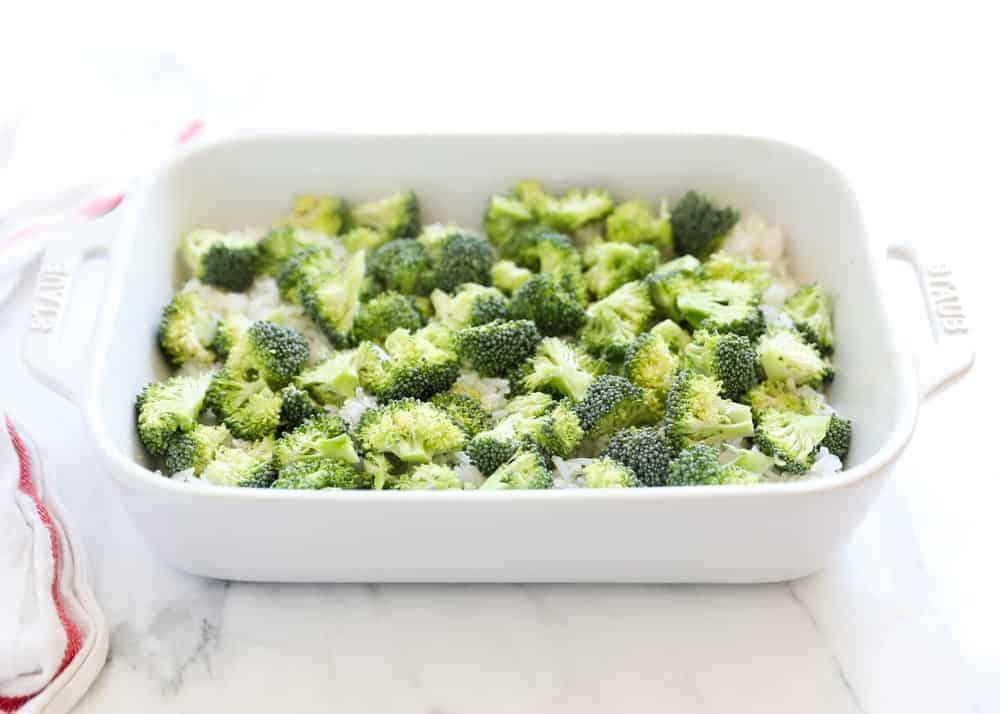 broccoli and rice in white casserole dish