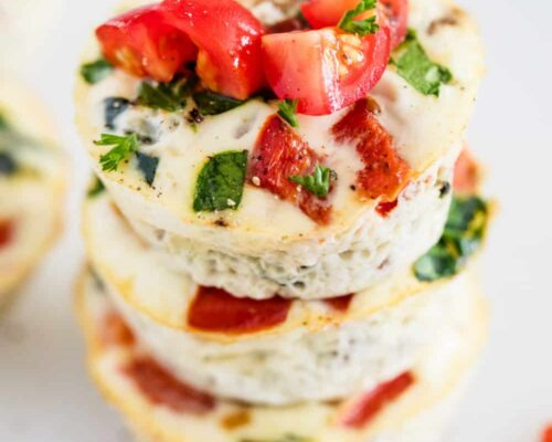 egg white muffins with tomatoes on top