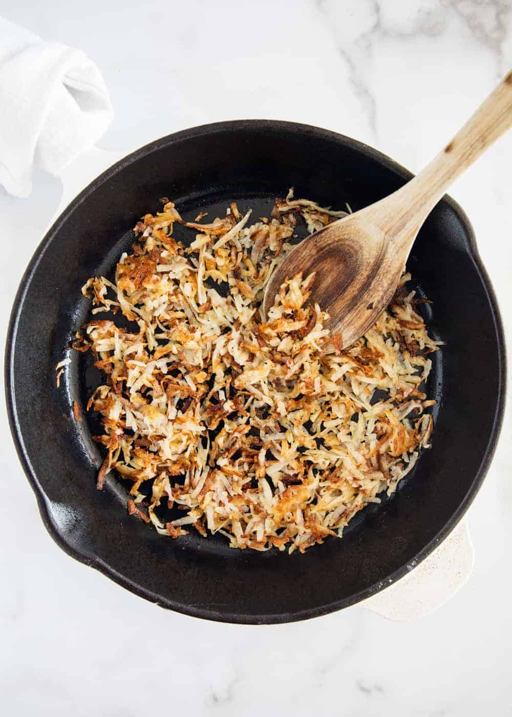 cooking hash browns in skillet