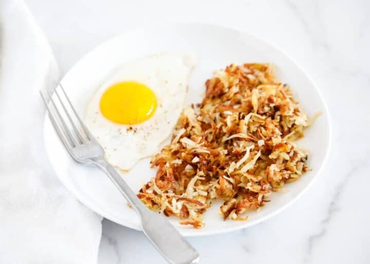 hash browns with a fried egg on a plate