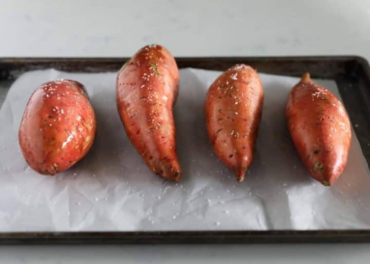 sweet potatoes on baking sheet coated in salt