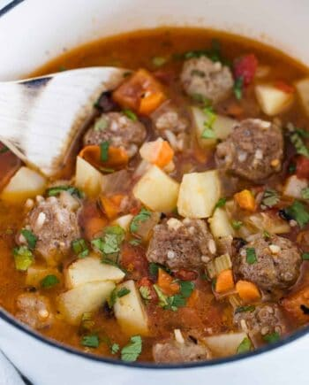mexican meatball soup in white pot