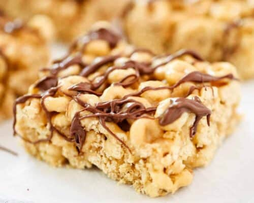 peanut butter cheerio bar with chocolate drizzled on top
