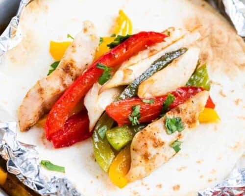 chicken fajitas on a flour tortilla
