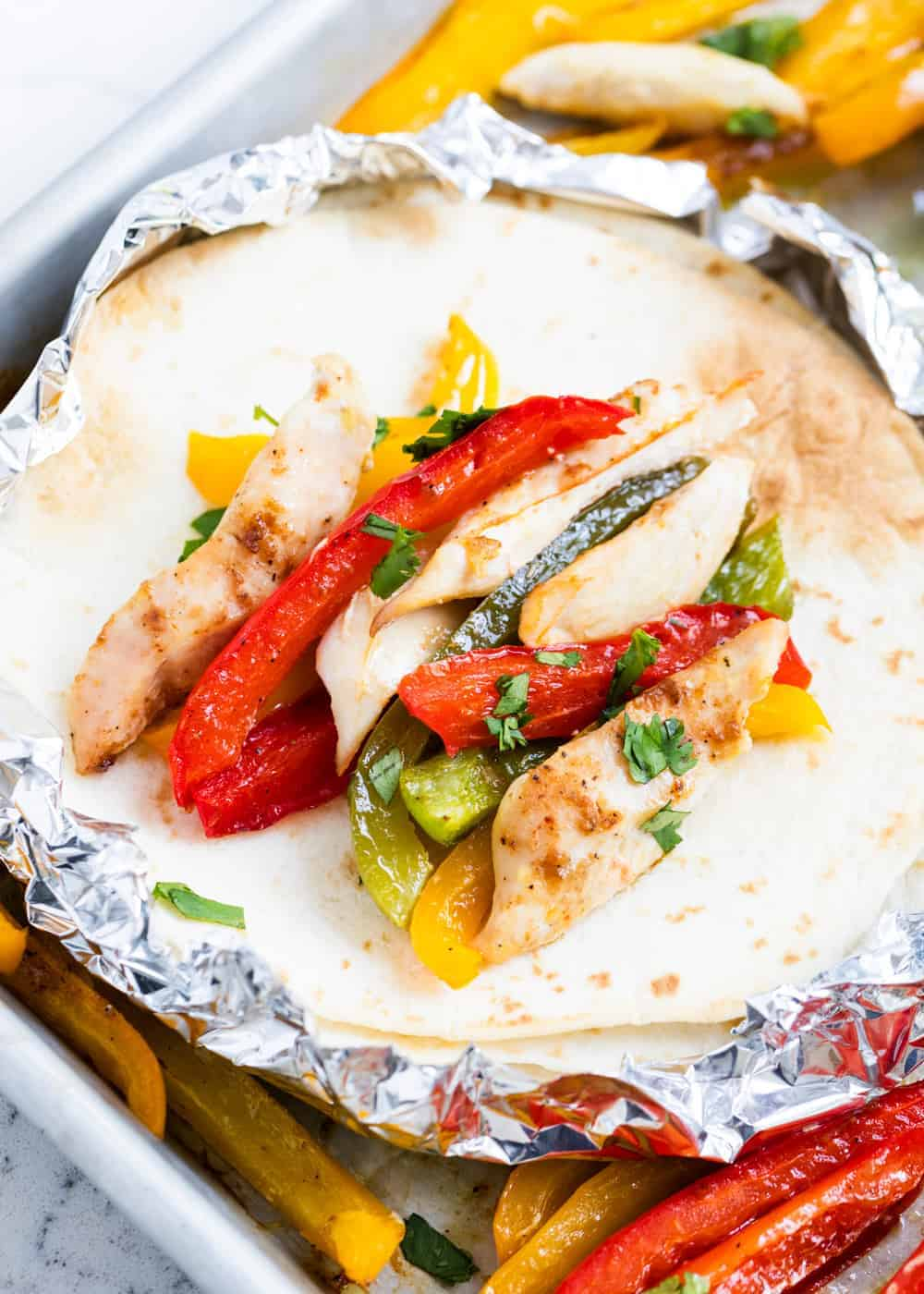 chicken fajitas on a flour tortilla