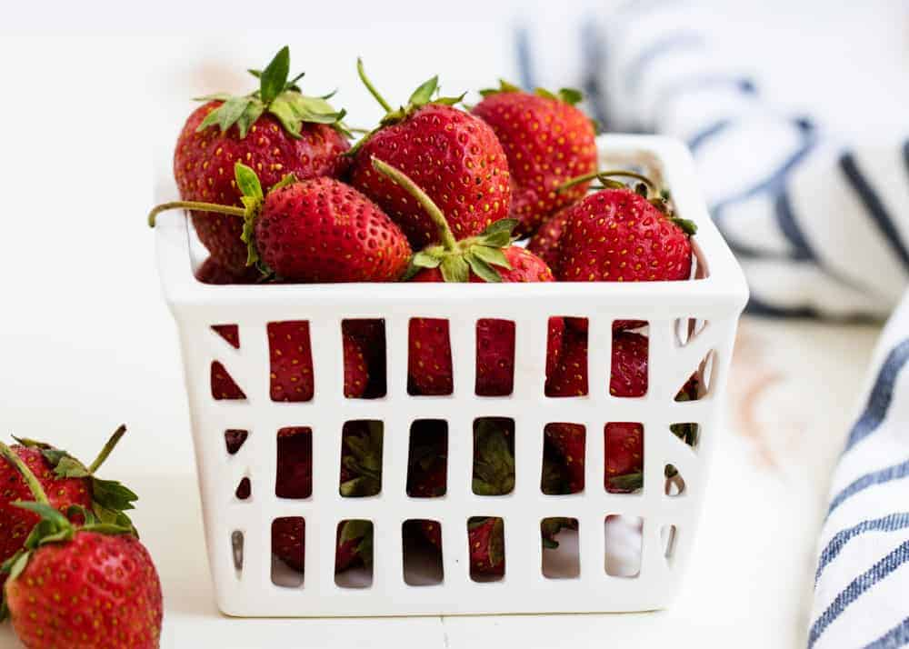 fresh strawberries in a white basket