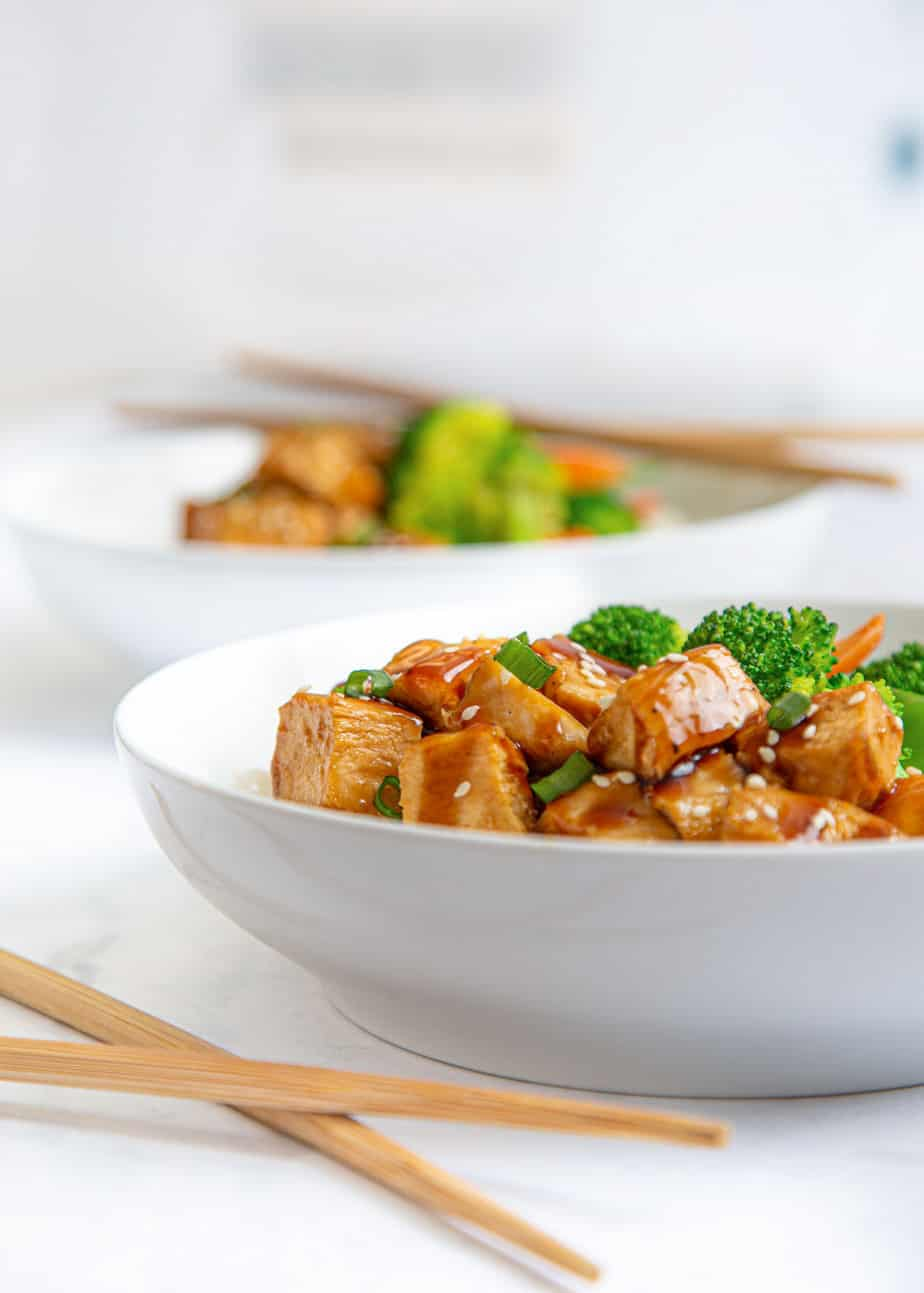 teriyaki chicken rice bowl with chopsticks