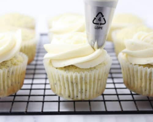 frosting lemon poppyseed cupcakes