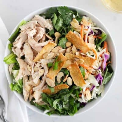asian chicken salad in white bowl