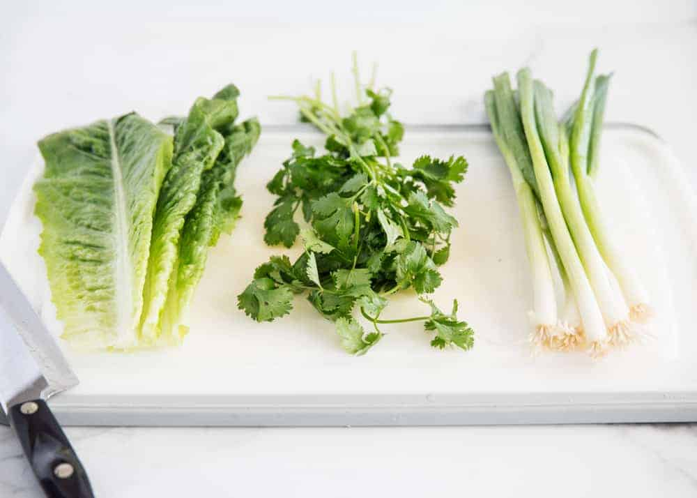 salad greens on cutting board