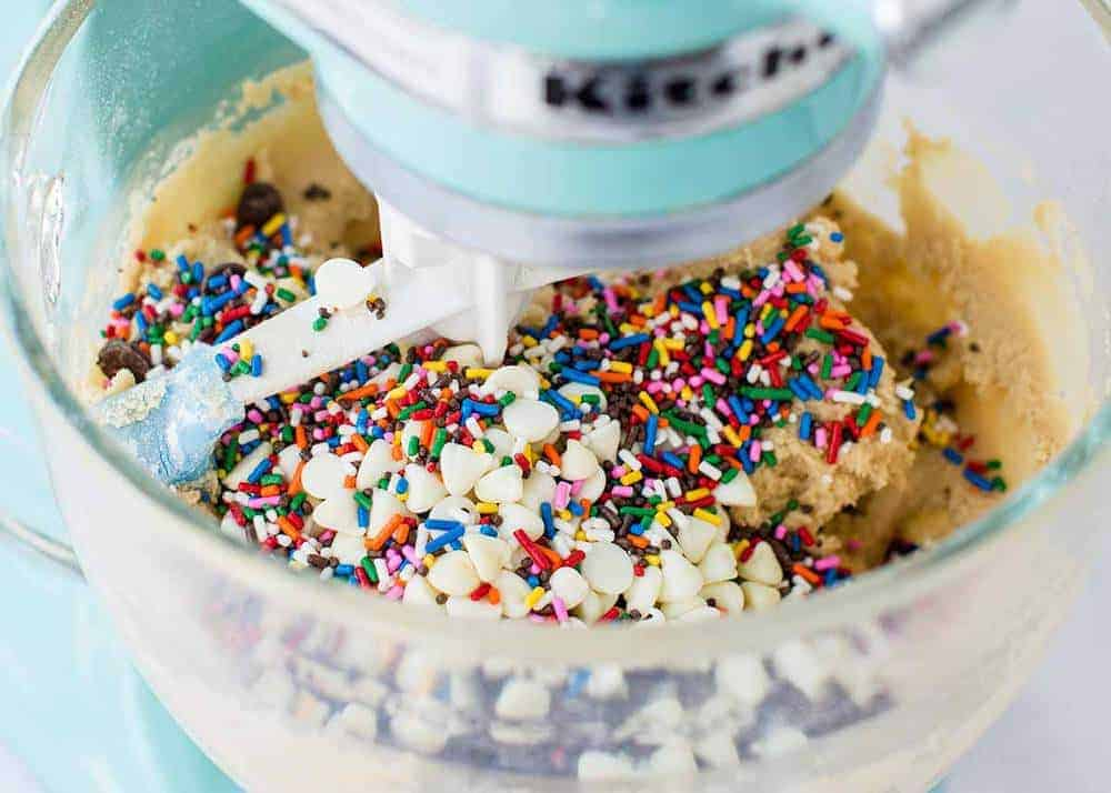 mixing sprinkles into dough with an electric mixer