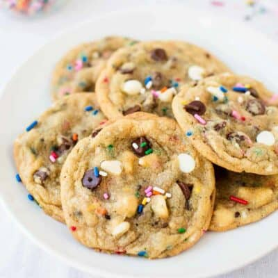 birthday chocolate chip cookies with sprinkles on a white plate