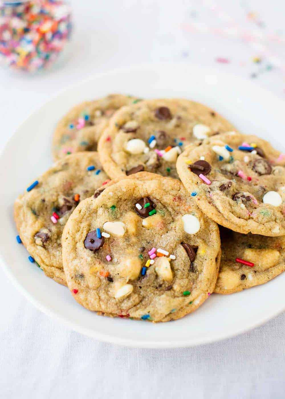 plate full of chocolate chip cookies with sprinkles