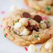 close up of a chocolate chip cookie with sprinkles