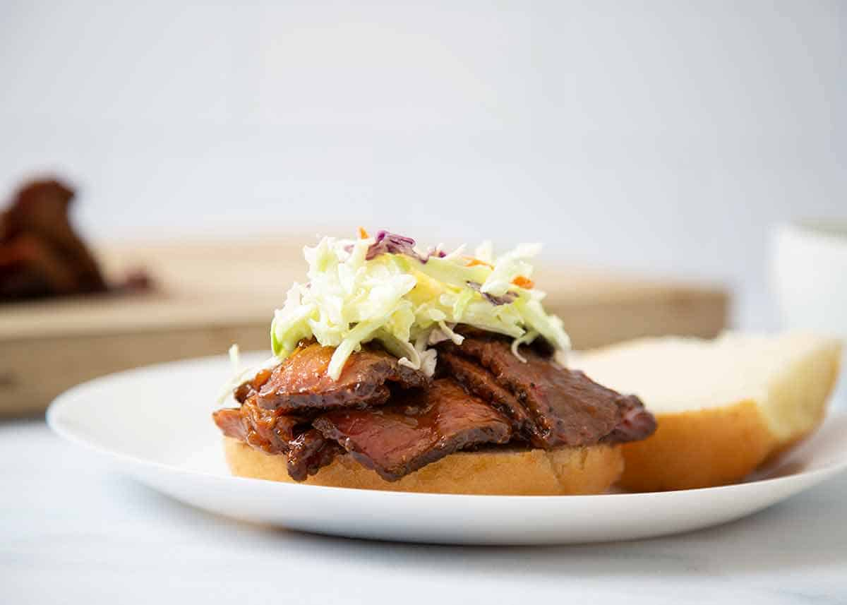 bbq brisket sandwich topped with coleslaw