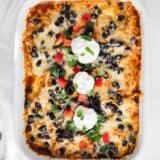 chicken enchilada casserole in white dish