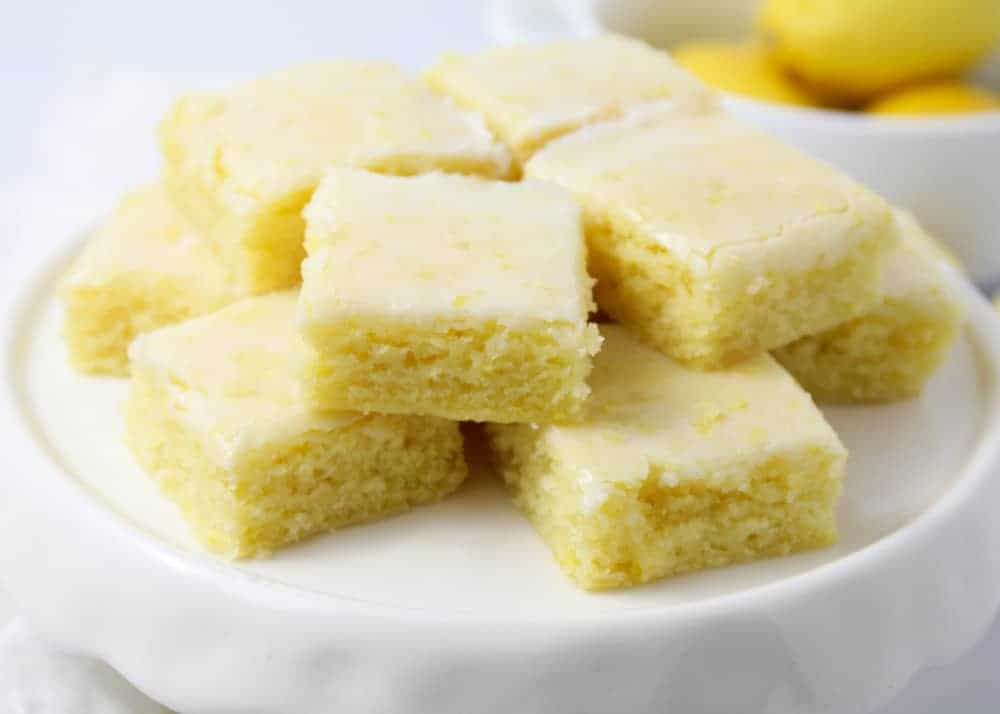 lemon brownies on a cake stand