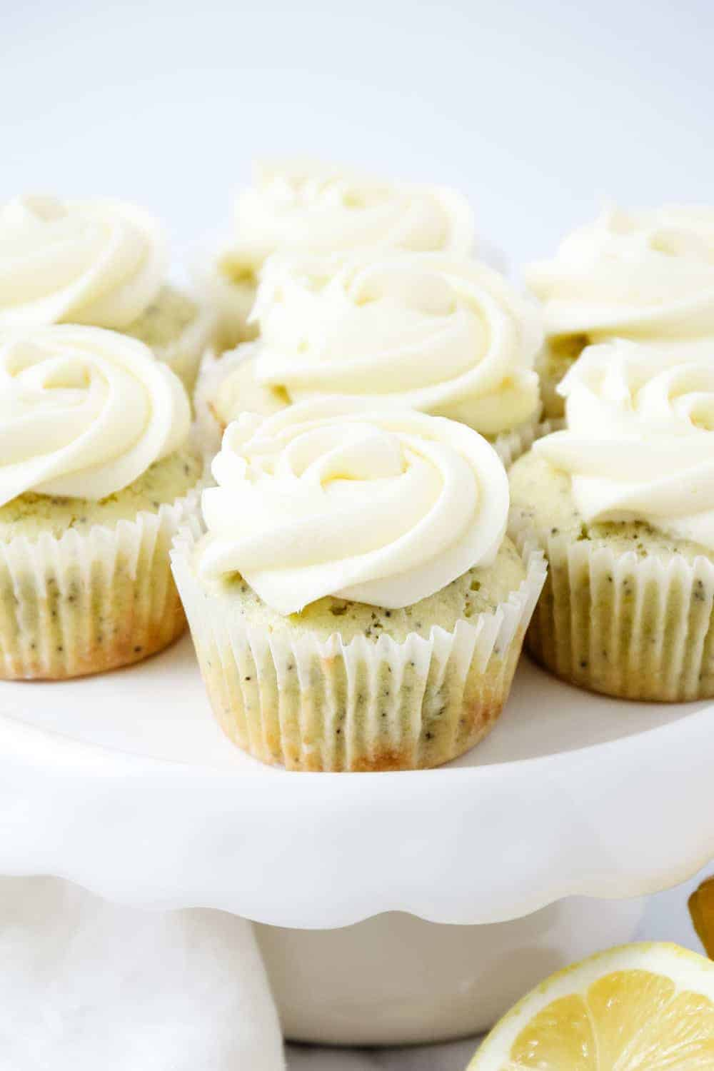 lemon poppy seed cupcakes on a cake stand
