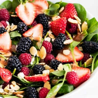 spinach salad with fresh berries and sliced almonds