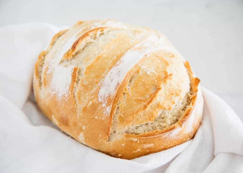 artisan bread in white towel