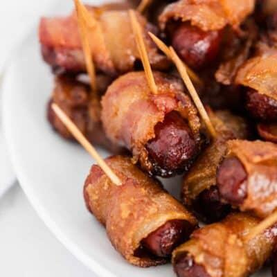 bacon wrapped smokies on white plate