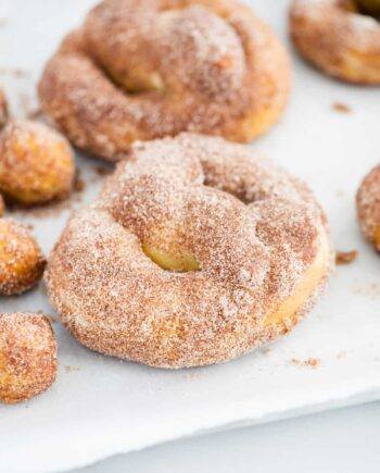 cinnamon sugar pretzels on parchment paper