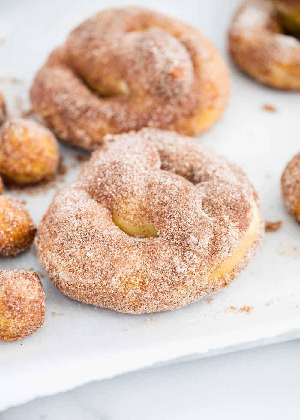 cinnamon sugar pretzels on parchment paper