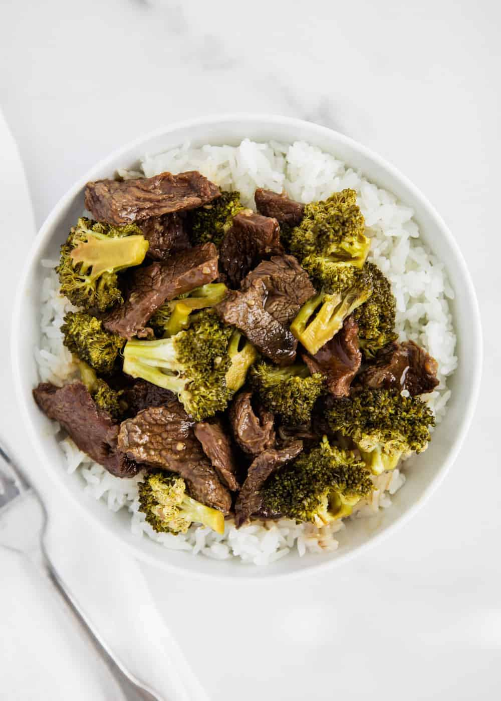 beef and broccoli in white bowl