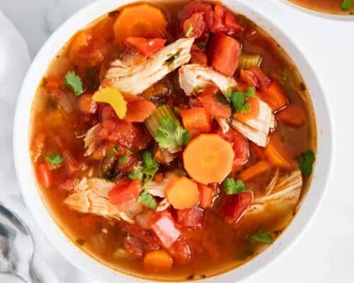 Mexican chicken soup in white bowl