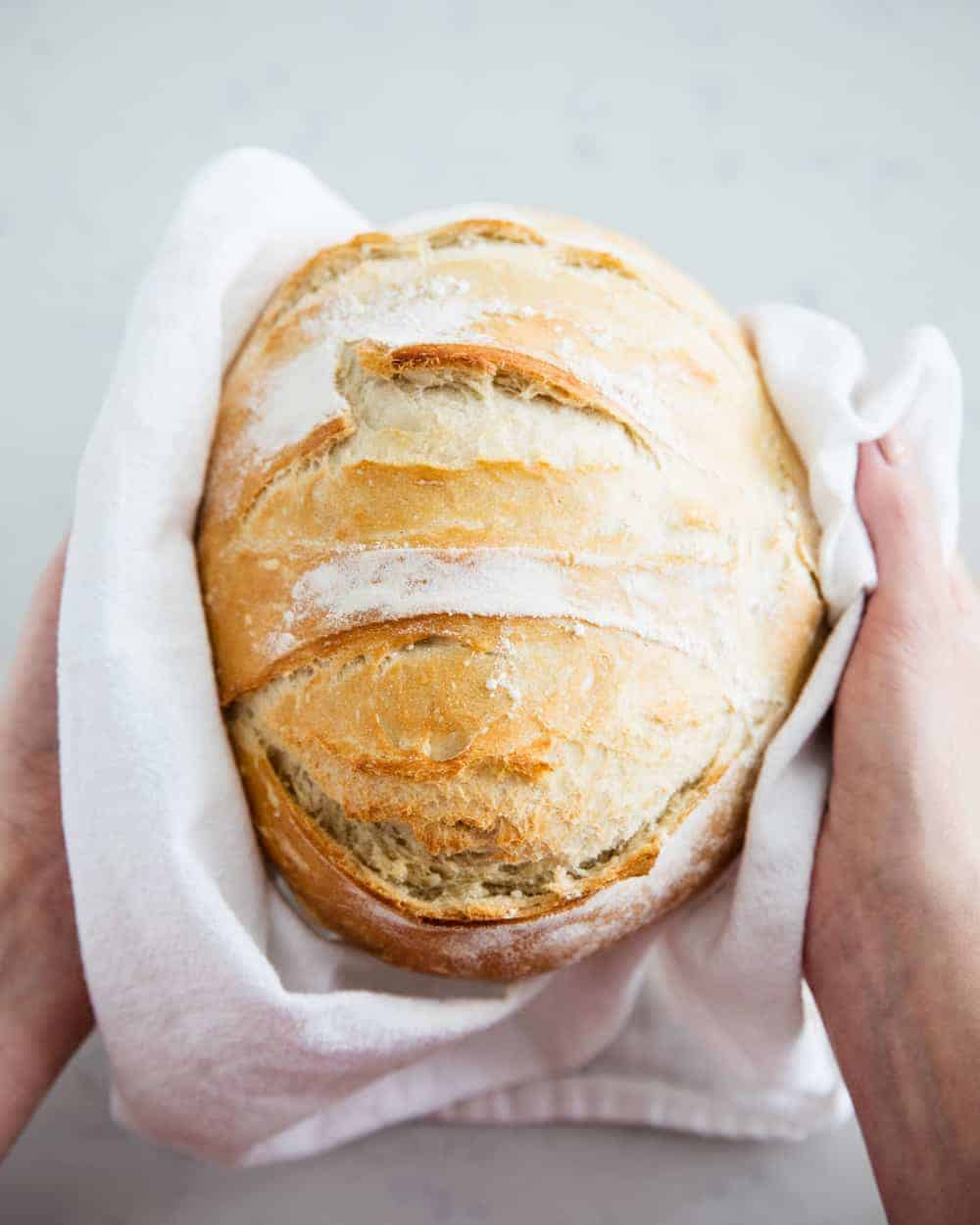 handing holding artisan bread