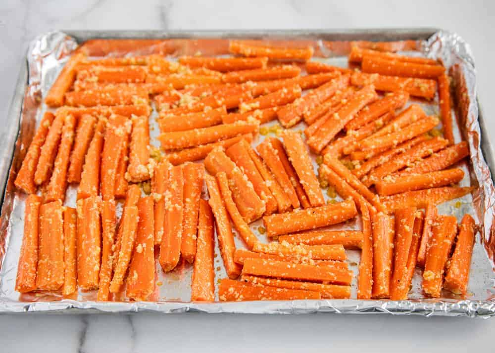 parmesan garlic carrots on pan