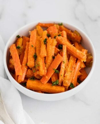 parmesan roasted carrots in white bowl