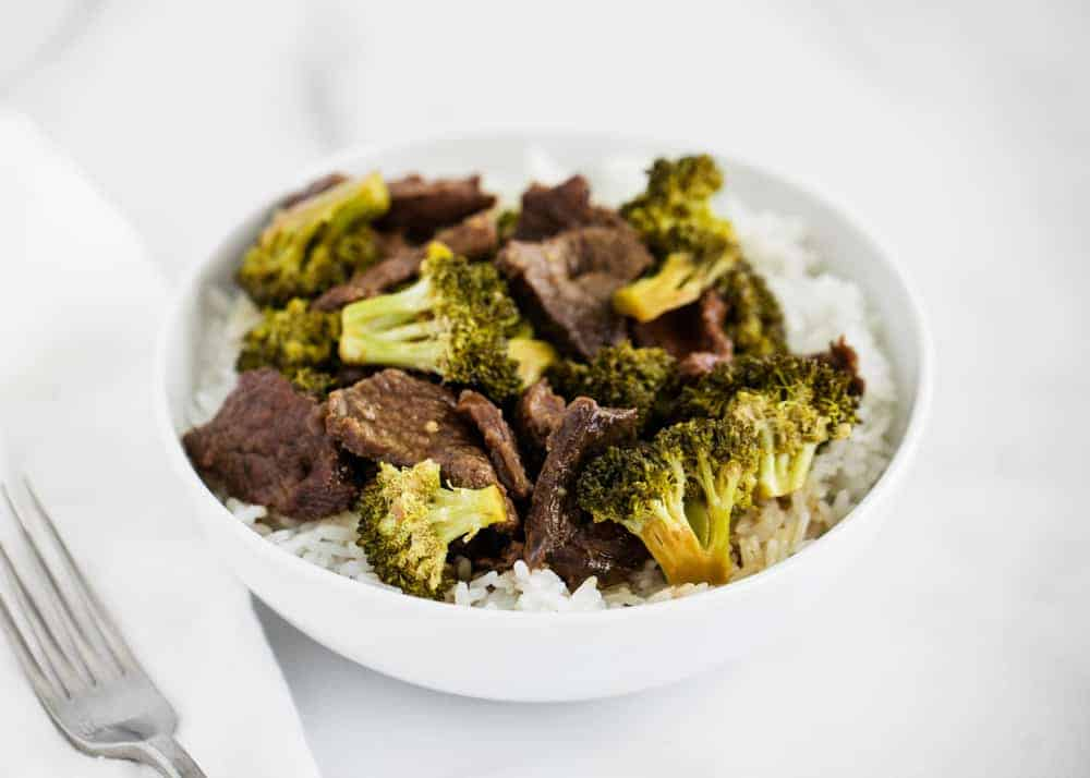 beef and broccoli in a white bowl