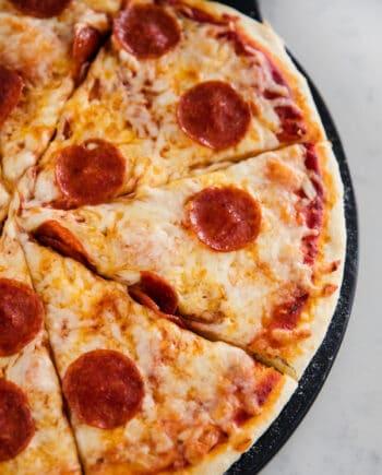 sliced pizza on pan