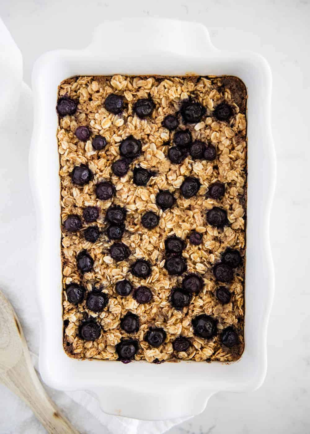blueberry baked oatmeal in white pan