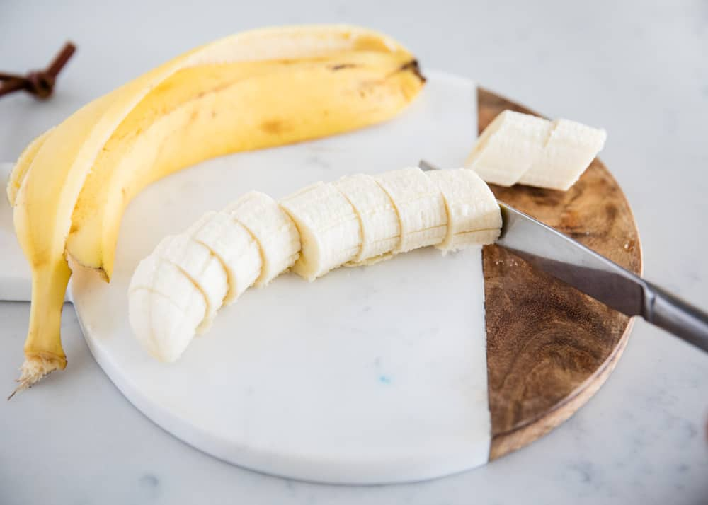 slicing bananas on cutting board