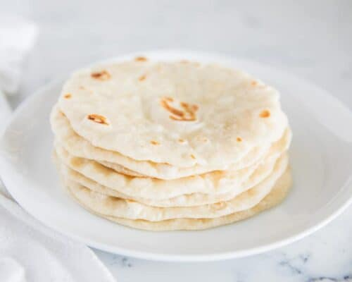 homemade tortillas on a white plate